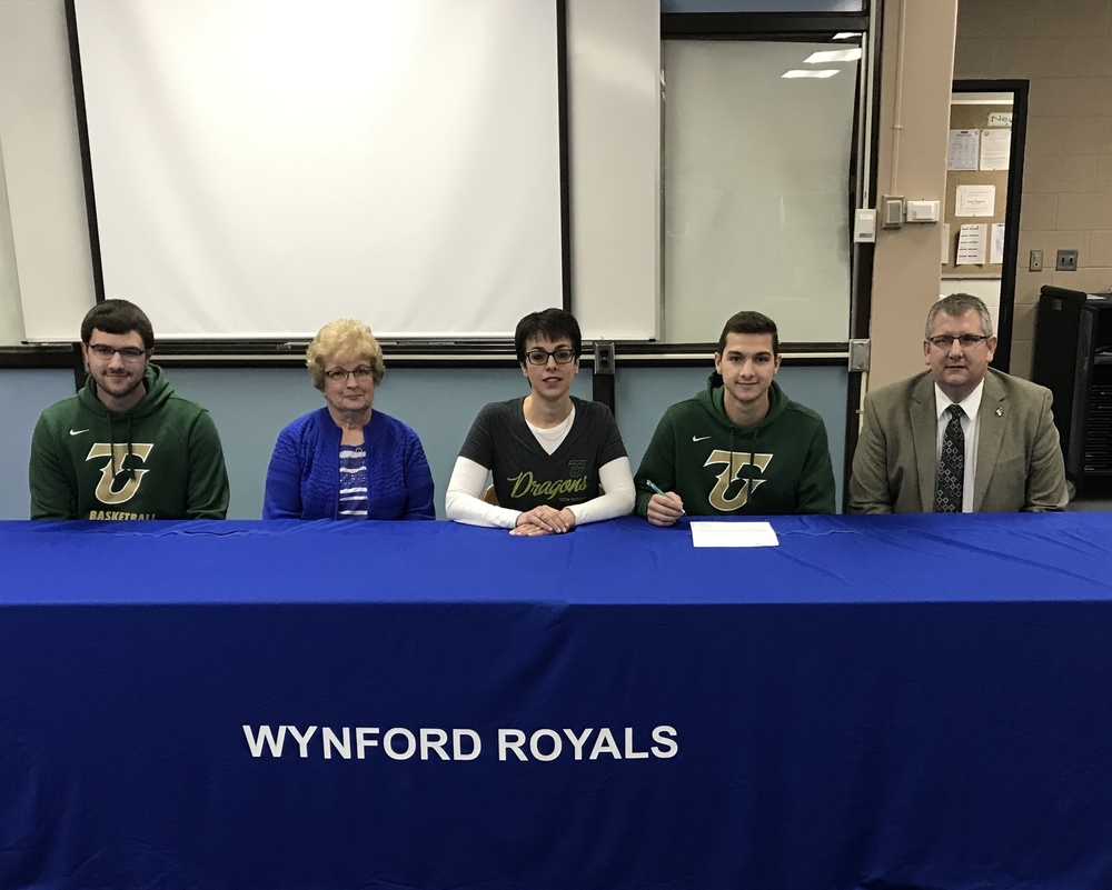 Josh Crall signs letter of intent to play basketball at Tiffin University.