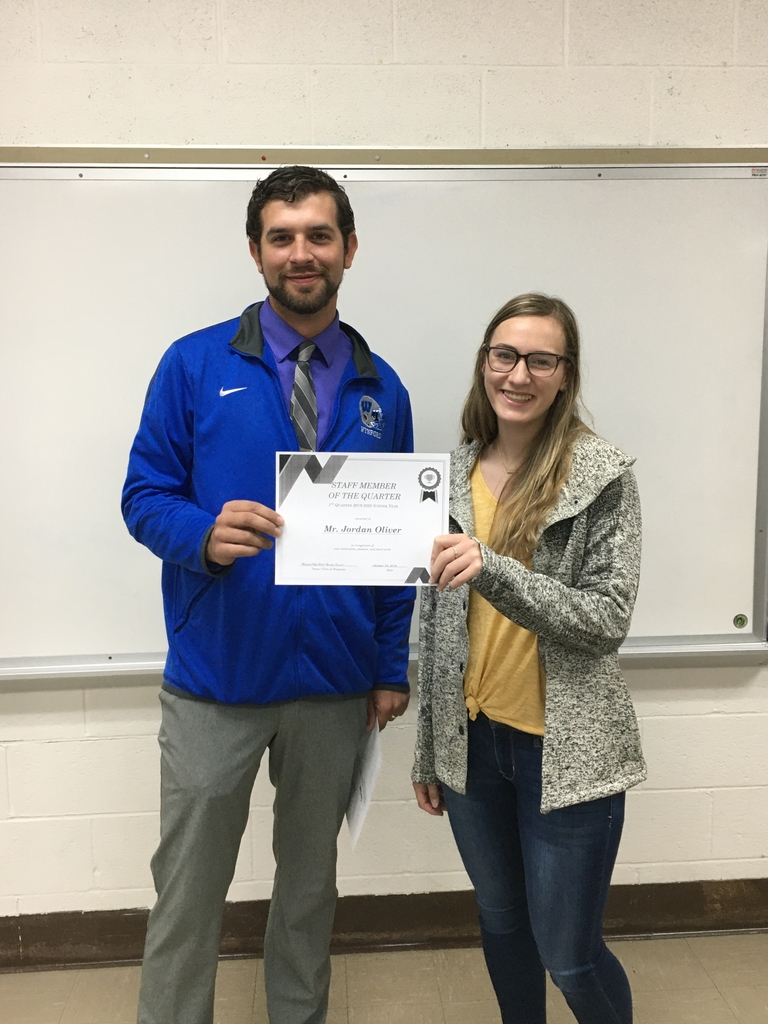 Lyndie Williams presents Mr. Oliver with his award for Staff Member of the Quarter.